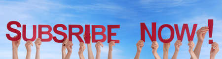 signup: Many People Holding the Red Words Subscribe Now in the Sky