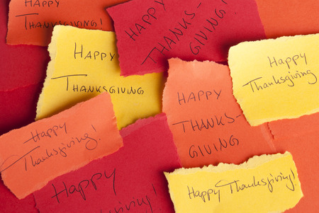 Many Memos with the Handwritten Words Happy Thanksgiving on it photo
