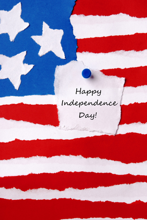 American Flag as Paper Background with a Note on which stands Happy Independence Day photo