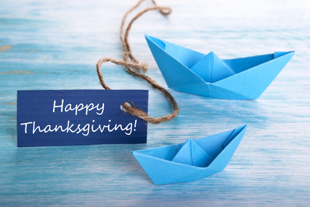 A Blue Banner with Happy Thanksgiving and Boats photo