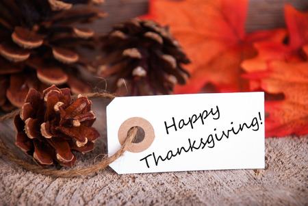 White Label with Happy Thanksgiving and a Fall Background Imagens