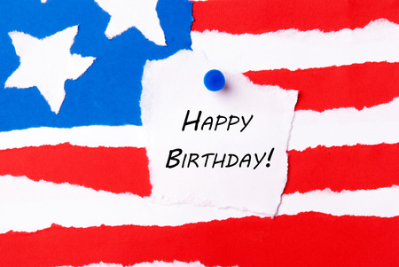 american flag background: Note with Happy Birthday on an American Flag Background