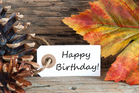 Autumn or Fall Background with a Label with Happy Birthday on it photo