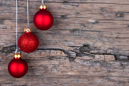 Three Red Christmas Tree Balls on Wood with Copy Space  photo