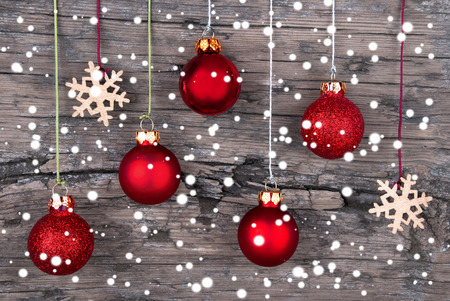 Christmas Balls and Snowflakes on Wood with Snowflakes as Christmas and Winter Background photo