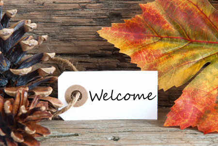 welcom: Autumn Background with the Word Welcome written on a label Stock Photo