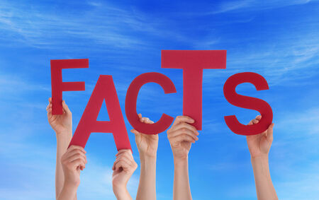 Many Hands Holding the Red Word Facts in the Sky Stock Photo