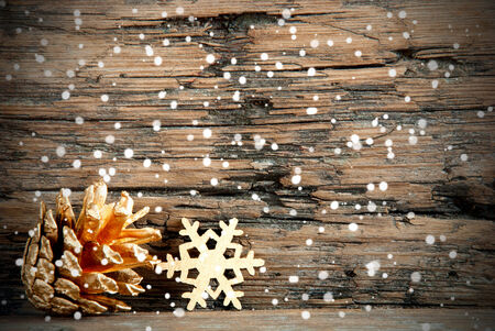 Golden Christmas Decoration on Wood with Snow photo