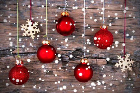 Christmas Background with Christmas Decorations and Snow on Wood photo