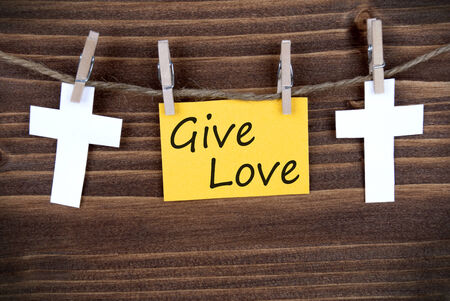 christian community: Yellow Banner with Give Love on a Line with Roods