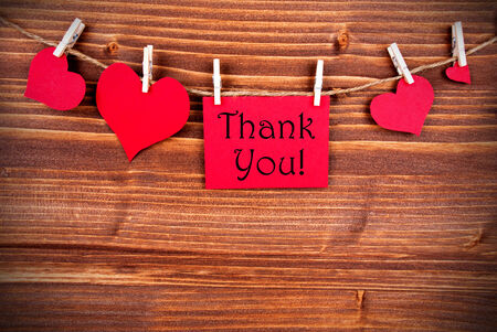 Thank You written on a red Tag with many Hearts on a Line photo