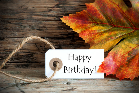 Autumn Label with the Words Happy Birthday on it photo