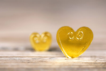 Two Golden Hearts on Wood with Copy Space photo