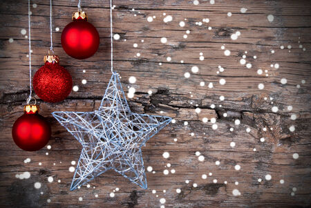 Christmas Background with red Christmas Balls and a Silver Christmas Star and Snowflakes photo