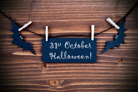 Black Label on a Line with the Words 31st Ocotber Halloween on wooden Background photo