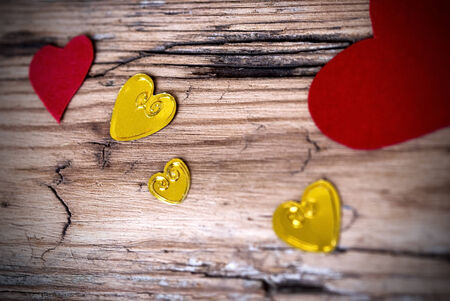 Lovely Heart Background with many Different Hearts on an Old Wooden Plank photo