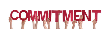 Many People Holding the Red Word Commitment, Isolated photo