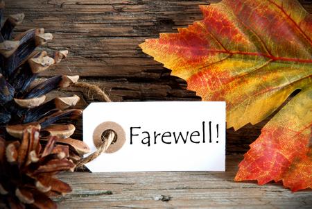 despedida: Una etiqueta de otoño con la Palabra de despedida en él, Fondo de la caída