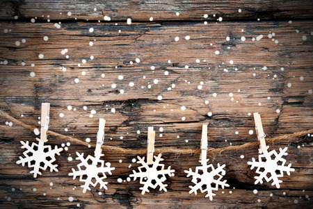 Snowflake-line with Snowflakes on Wood as Christmas and Winter Background photo