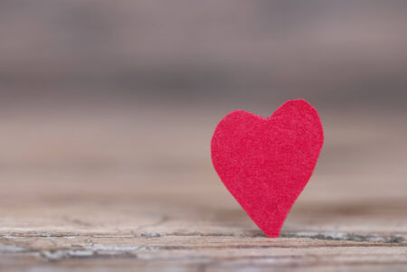 A Red Heart on Wood with Copy Space photo
