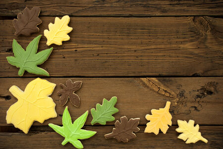 bickie: Autumnal Cookies on Wooden Planks as Fall Background with Copy Space Stock Photo
