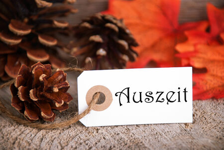 auszeit: An Autumnal Label with the German Word Auszeit which means Downtime on it, Fall Background