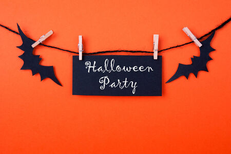 Black Label with the Words Halloween Party on Orange Background photo