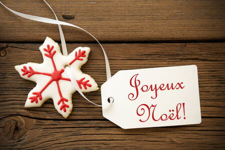 joyeux: Joyeux No�l, which is French and means Merry Christmas, on a Label with a red white Christmas Star Cookie