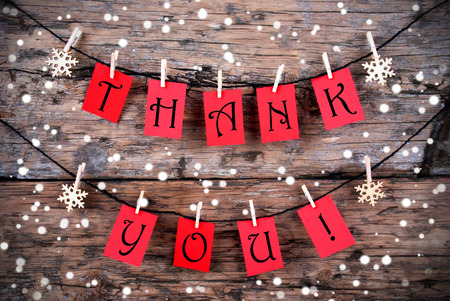 christmas season: Thank You on Red Tags Hanging on a Line in the Snow
