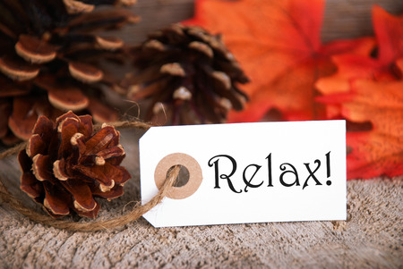 healthfulness: An Autumnal Label with the Word Relax on it, Fall Background Stock Photo