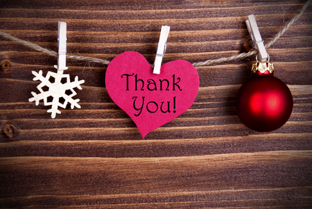 The Words Thank You on a Heart on a Line with Christmas Decoration or Winter Decoration photo