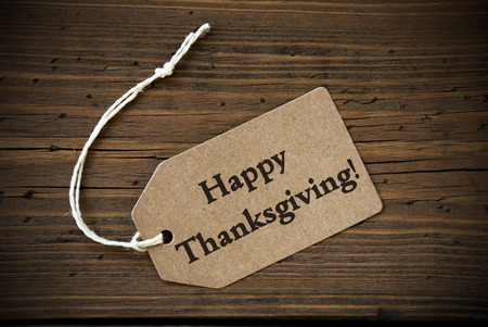 happy thanksgiving: Rustic Natural Label with the Words Happy Thanksgiving on it on Wooden Background