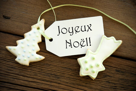 joyeux: The French Words Joyeux No�l, which means Merry Christmas, on a Label with Christmas Cookies