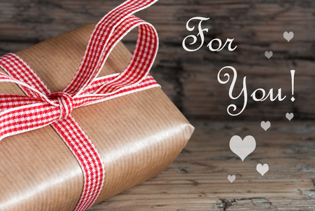 A Rustic Gift with red white Ribbon and the Text For You photo