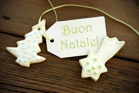 The Italian Words Buon Natale, which means Merry Christmas, on a Label with Christmas Cookies photo