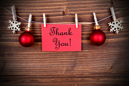 Christmas or Winter Background with a Red Label with the Words Thank You on a Line photo