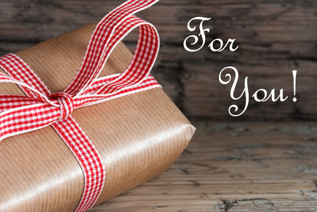 Present with Ribbon and the Words For You on Wooden Background photo