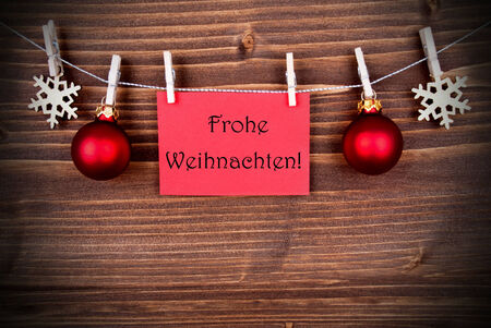 frohe: Red Banner with the German Words Frohe Weihnachten which means Merry Christmas Hanging on a Line, German Christmas Greetings