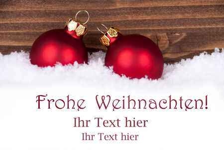 frohe: Frohe Weihnachten, german Christmas Greetings which means Merry Christmas, in the Snow with red Christmas Balls and Space for your Text