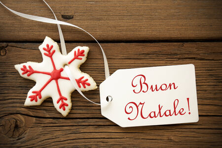 Buon Natale, which is Italian and means Merry Christmas, on a Label with a red white Christmas Star Cookie photo
