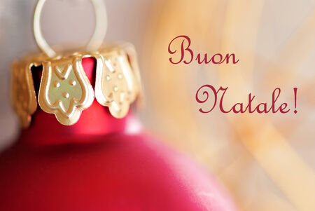 buon: Macro of a Red Christmas Decoration Ball with the Italian Words Buon Natale which means Merry Christmas