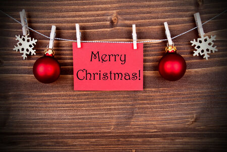 The Words Merry Christmas on a red Banner Hanging on a Line photo