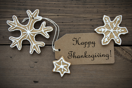 happy thanksgiving: Happy Thanksgiving written on a brown Label with Ginger Bread Cookies with white Decoration, Thanksgiving Background