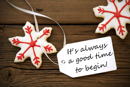 Red Christmas Stars Cookie  With White Label With Life Quote Saying It Is Always A Good Time To Begin On Wooden Background Stock Photo