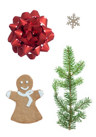 christmas ornamentation: Christmas Set On A White Background With Gingerbread Woman, Fir Tree Branch, Snowflake and Red Ribbon