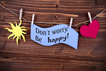 dont worry: Blue Tag Or Label With Sun And Heart On A Line With Life Quote Dont Worry Be Happy On Wooden Background, Two Symbols, Vintage, Retro And Old Fashion Style With Frame Stock Photo