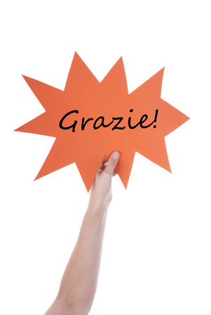 verticals: Hand Holding A Orange Speech Balloon Or Speech Bubble With Italian Grazie. Isolated Photo