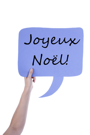 l hand: Hand Holding A Light Purple Speech Balloon Or Speech Bubble With French Joyeux No�l. Isolated Photo