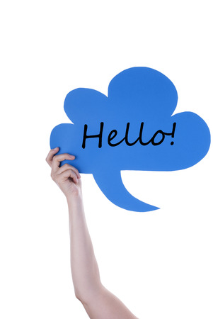 Hand Holding A Blue Speech Balloon Or Speech Bubble With Hello. Isolated Photo photo