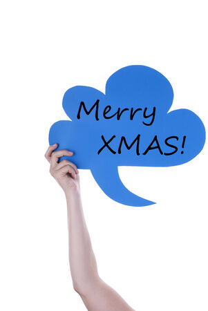 verticals: Hand Holding A Blue Speech Balloon Or Speech Bubble With Merry Xmas. Isolated Photo